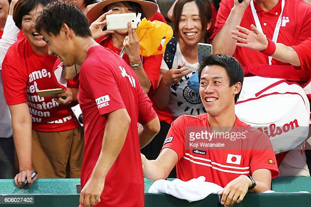 Kei Nishikori of Japan celebrates the winner Illya Marchenko of Ukraine during the Davis Cup World Group Playoff singles match betweenat Utsubo...