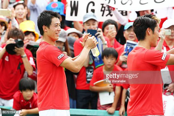 Kei Nishikori of Japan celebrates the winner with teammate during the Davis Cup World Group Playoff doubles match between at Utsubo Tennis Center on...