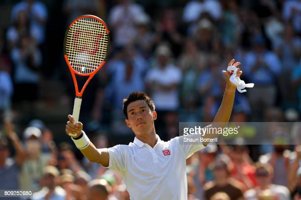 Kei Nishikori of Japan celebrates victory after the Gentlemen's Singles second round match against Sergiy Stakhovsky of Ukraine on day three of the...