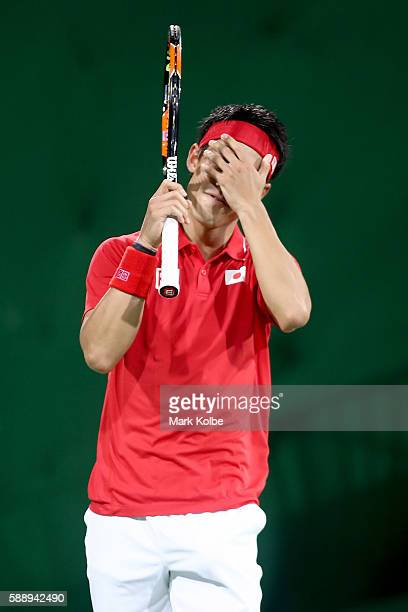 Kei Nishikori of Japan celebrates victory against Gael Monfils of France in the Men's Singles Quarterfinal on Day 7 of the Rio 2016 Olympic Games at...