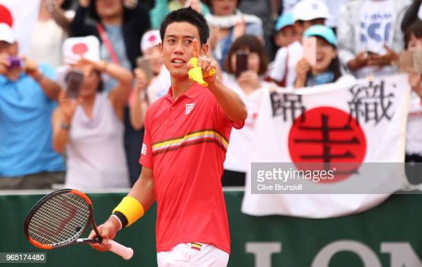 Kei Nishikori of Japan celebrates victory during his mens singles third round match against Gilles Simon of France during day six of the 2018 French...