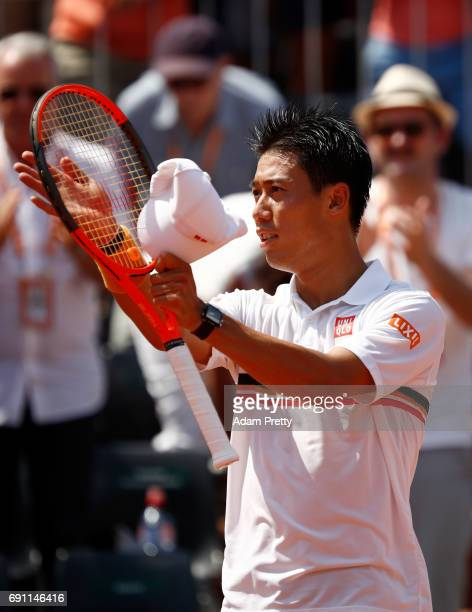 Kei Nishikori of Japan celebrates victory during the men's singles second round match against Jeremy Chardy of France on day five of the 2017 French...