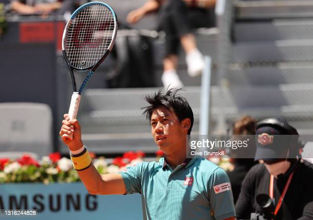 Kei Nishikori of Japan celebrates victory in his mens singles first round match against Karen Khachanov of Russia during day six of the Mutua Madrid...