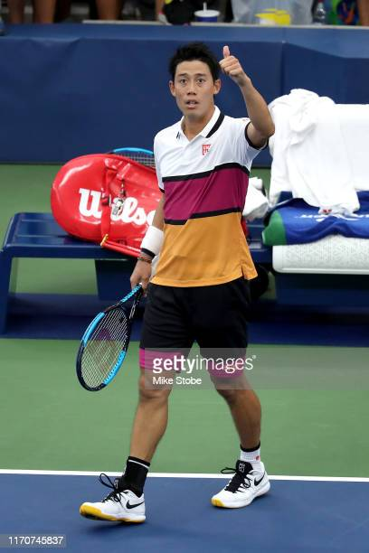 Kei Nishikori of Japan celebrates victory in his Men's Singles second round match against Bradley Klahn of the United States on day three of the 2019...