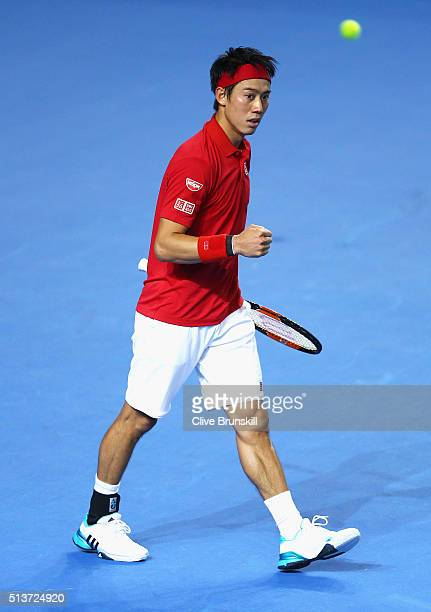 Kei Nishikori of Japan celebrates victory in his singles match against Daniel Evans of Great Britain during day one of the Davis Cup World Group...
