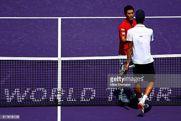 Kei Nishikori of Japan celebrates winning a match against PierreHugues Herbert of France during Day 6 of the Miami Open presented by Itau at Crandon...