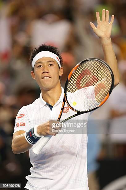 Kei Nishikori of Japan celebrates winning his fourth round match against JoWilfried Tsonga of France during day seven of the 2016 Australian Open at...