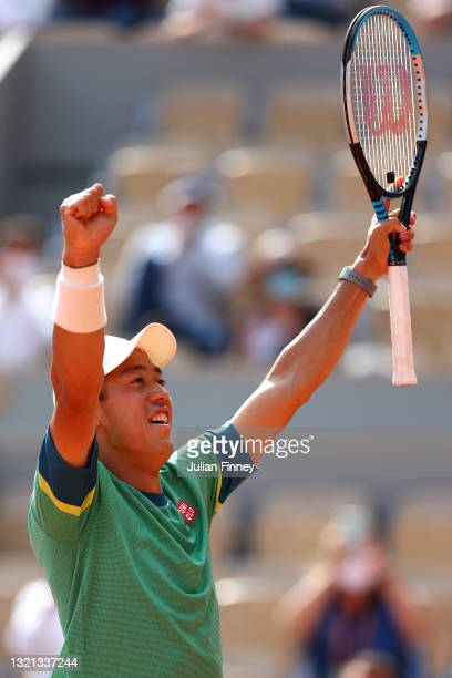 Kei Nishikori of Japan celebrates winning his mens second round match against Karen Khachanov of Russia during day four of the 2021 French Open at...