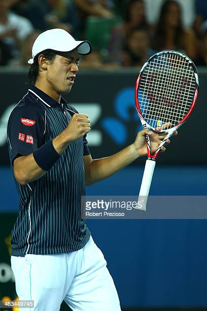 Kei Nishikori of Japan celebrates winning his third round match against Donald Young of the United States during day six of the 2014 Australian Open...