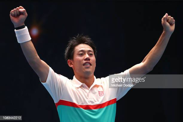 Kei Nishikori of Japan celebrates winning match point in his second round match against Ivo Karlovic of Croatia during day four of the 2019...