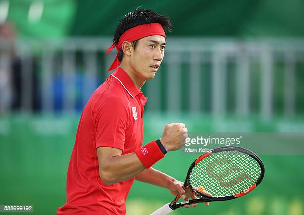 Kei Nishikori of Japan celebrates winning the first set against Gael Monfils of France in the Men's Singles Quarterfinal on Day 7 of the Rio 2016...