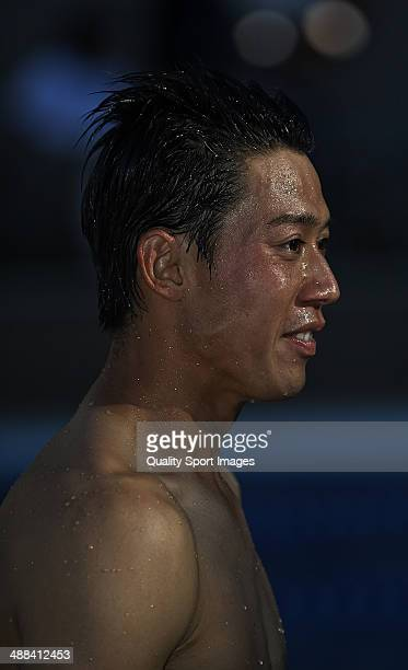 Kei Nishikori of Japan celebrating his victory into the club's pool after his victory against Santiago Giraldo of Colombia after day eight of the ATP...