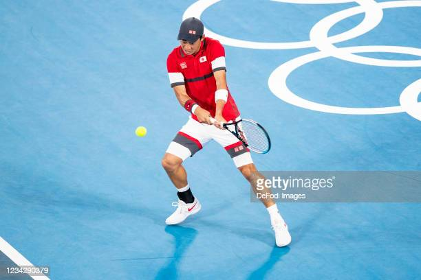 Kei Nishikori of Japan compete in the Men's Singles Quarterfinal Tennis Match between Serbia and Japan on day six of the Tokyo 2020 Olympic Games at...