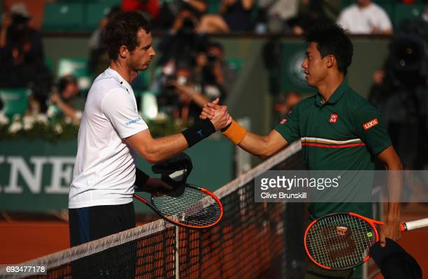 Kei Nishikori of Japan congratulates Andy Murray of Great Britain on victory following the mens singles quarter finals match on day eleven of the...