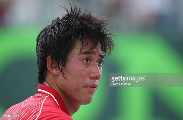 Kei Nishikori of Japan during the change over during his three set victory against David Ferrer of Spain during their fourth round match during day 9...