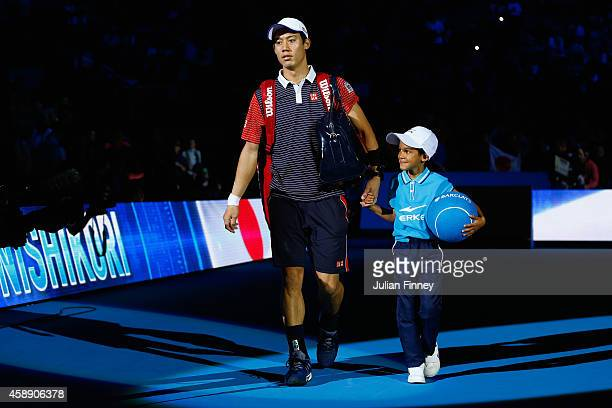 Kei Nishikori of Japan enters the court for the round robin singles match againstKei Nishikori of Japan on day five of the Barclays ATP World Tour...