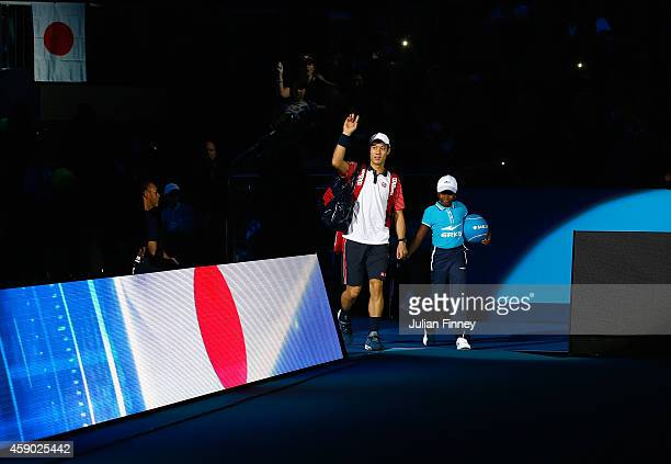 Kei Nishikori of Japan enters the court in the singles semifinal match against Novak Djokovic of Serbia on day seven of the Barclays ATP World Tour...