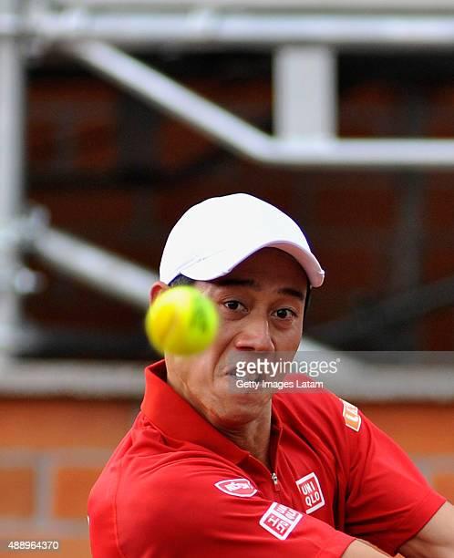 Kei Nishikori of Japan eyes a ball during the Davis Cup World Group Playoff singles match between Alejandro Falla of Colombia and Kei Nishikori of...