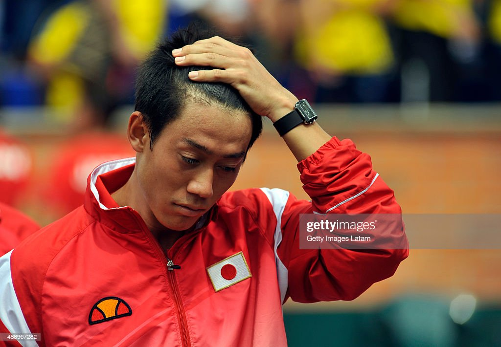 Kei Nishikori of Japan gestures prior to the Davis Cup World Group Play-off singles match between Alejandro Falla of Colombia and Kei Nishikori of Japan at Club Campestre on September 18, 2015 in Pereira, Colombia.