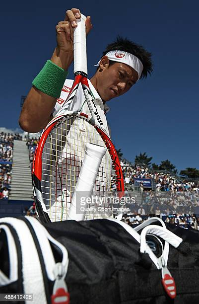 Kei Nishikori of Japan gets his racket prior to the start against Santiago Giraldo of Colombia during day eight of the ATP Barcelona Open Banc...