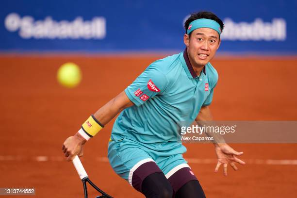 Kei Nishikori of Japan has eyes on the ball after playing a backhand against Cristian Garin of Chile in their second round match during day three of...
