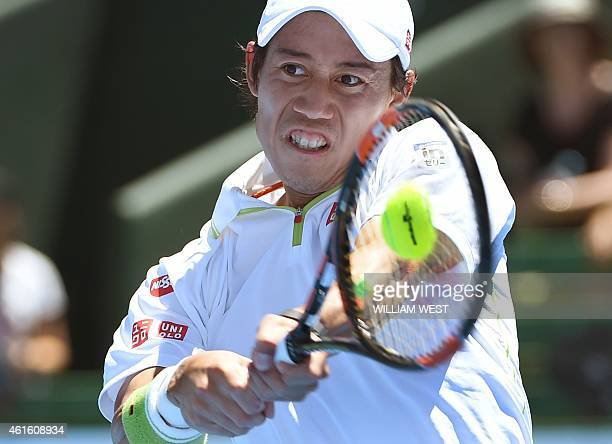 Kei Nishikori of Japan hits a backhand return during the third and fourth playoff match against Richard Gasquet of France at the Kooyong Classic...