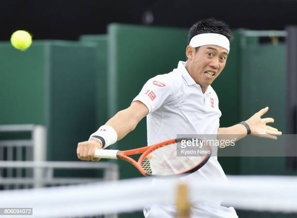 Kei Nishikori of Japan hits a backhand slice during his Wimbledon firstround match against Marco Cecchinato of Italy in London on July 3 2017 ==Kyodo
