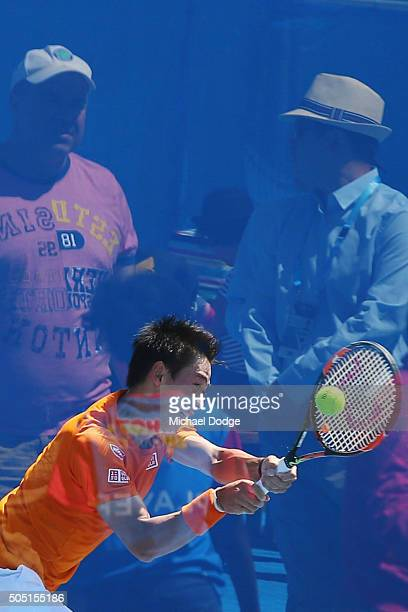 Kei Nishikori of Japan hits a forehand uring a practice session ahead of the 2016 Australian Open at Melbourne Park on January 16 2016 in Melbourne...