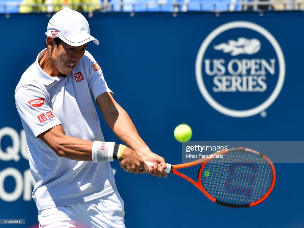 Kei Nishikori of Japan hits a return against Gael Monfils of France during day six of the Rogers Cup presented by National Bank at Uniprix Stadium on August 9, 2017 in Montreal, Quebec, Canada.
