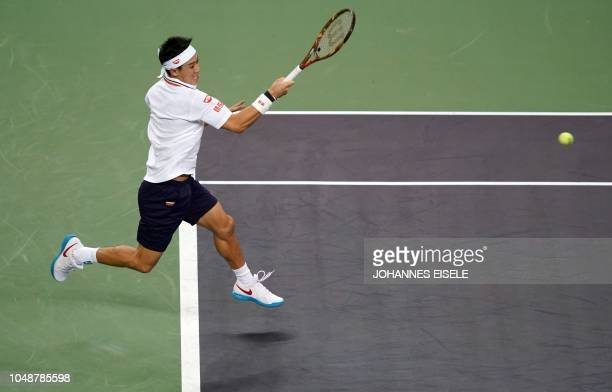 Kei Nishikori of Japan hits a return against Wu Yibing of China during their men's singles second round match at the Shanghai Masters tennis...
