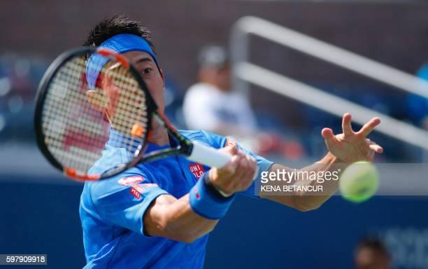 Kei Nishikori of Japan hits a return to Benjamin Becker of Germany during their 2016 US Open Men's Singles match at the USTA Billie Jean King...
