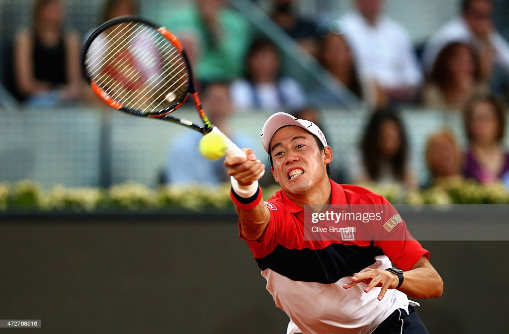 Kei Nishikori of Japan in action against Andy Murray of Great Britain in their semi final match during day eight of the Mutua Madrid Open tennis tournament at the Caja Magica on May 9, 2015 in Madrid, Spain.