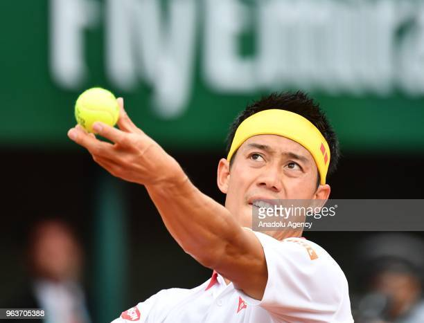 Kei Nishikori of Japan in action against Benoit Paire of France during their second round match at the French Open tennis tournament at Roland Garros...