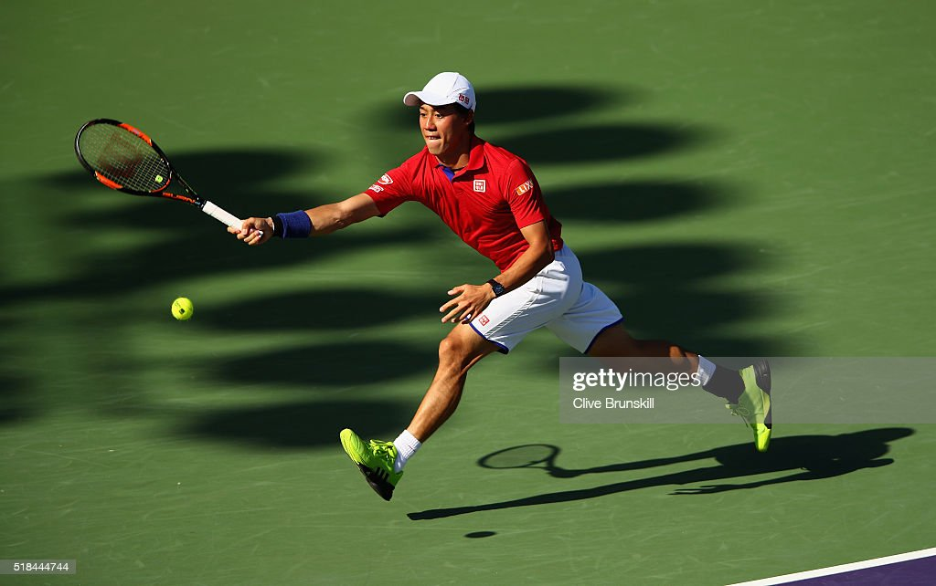 Kei Nishikori of Japan in action against Gael Monfils of France in their quarter final match during the Miami Open Presented by Itau at Crandon Park Tennis Center on March 31, 2016 in Key Biscayne, Florida.