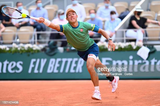 Kei Nishikori of Japan in action against Karen Khachanov of Russia on Court Philippe-Chatrier during the second round of the singles competition at...