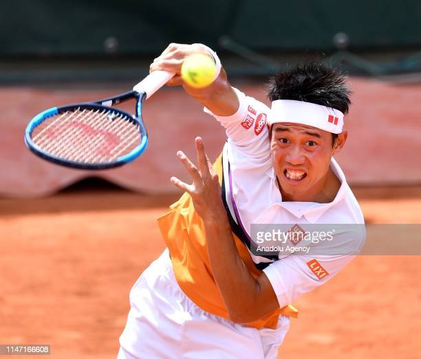 Kei Nishikori of Japan in action against Laslo Djere of Serbia during their third round match at the French Open tennis tournament at Roland Garros...