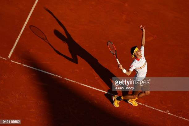 Kei Nishikori of Japan in action against Marin Cilic of Croatia during day six of the ATP Masters Series Monte Carlo Rolex Masters at MonteCarlo...