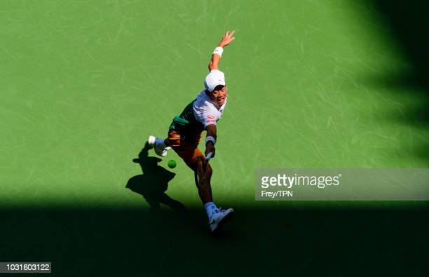 Kei Nishikori of Japan in action against Marin Cilic of Croatia during the quarterfinal match on day 10 of the US Open at the USTA Billie Jean King...