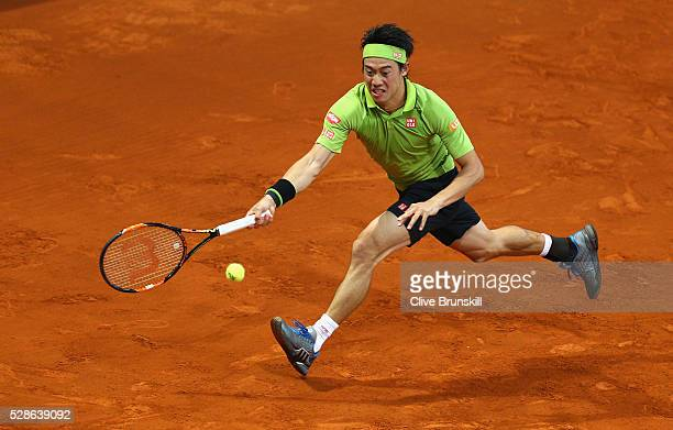Kei Nishikori of Japan in action against Nick Kyrgios of Australia in their quarter final round match during day seven of the Mutua Madrid Open...
