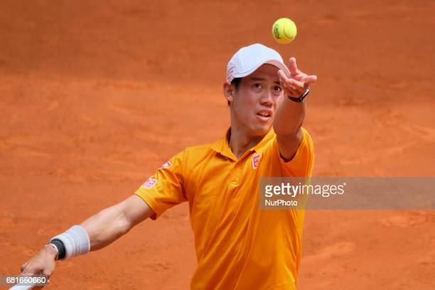 Kei Nishikori of Japan in action as he wins against Diego Schwartzman of Argentina in a tough 3 sets at Caja Magica Madrid Spain during Mutua Madrid...