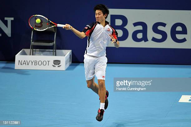 Kei Nishikori of Japan in action during his match against Tomas Berdych of Czech Republic during day two of the Swiss Indoors at St Jakobshalle on...