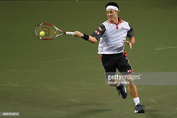 Kei Nishikori of Japan in action during the men's singles second round match against Ivan Dodig of Croatia on day three of Rakuten Open 2014 at...