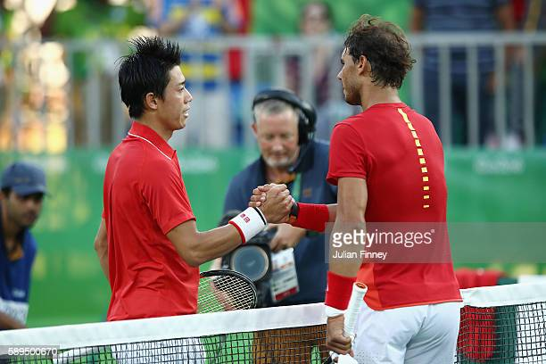 Kei Nishikori of Japan is congratualted by Rafael Nadal of Spain after winning the singles bronze medal match on Day 9 of the Rio 2016 Olympic Games...