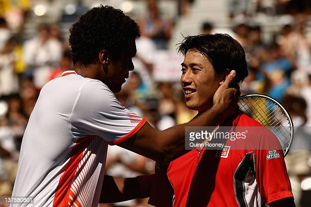 Kei Nishikori of Japan is congratulated by JoWilfried Tsonga of France after their fourth round match during day eight of the 2012 Australian Open at...