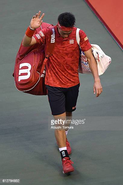 Kei Nishikori of Japan leaves the court after announcing withdrawal from the men's singles second round match against Joao Sousa of Portugal on day...
