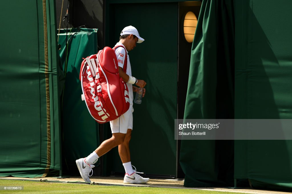 Kei Nishikori of Japan looks dejected in defeat after the Gentlemen's Singles third round match against Roberto Bautista Agut of Spain on day five of the Wimbledon Lawn Tennis Championships at the All England Lawn Tennis and Croquet Club on July 7, 2017 in London, England.