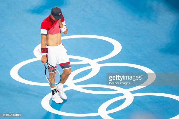 Kei Nishikori of Japan looks dejected in the Men's Singles Quarterfinal Tennis Match between Serbia and Japan on day six of the Tokyo 2020 Olympic...