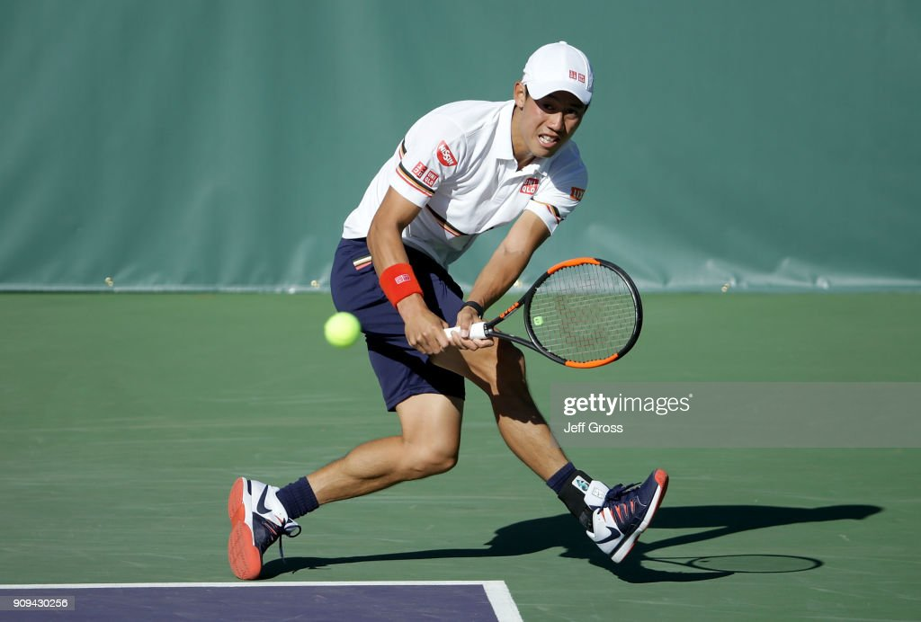 Kei Nishikori of Japan lunges to return a backhand to Dennis Novikov during the first round of the Oracle Challenger Series at the Newport Beach Tennis Club on January 23, 2018 in Newport Beach, California.