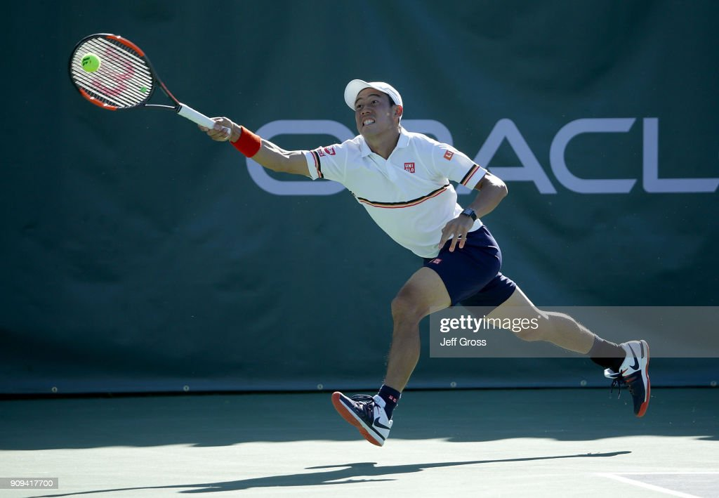 Kei Nishikori of Japan lunges to return a forehand against Dennis Novikov during the first roud of the Oracle Challenger Series at the Newport Beach Tennis Club on January 23, 2018 in Newport Beach, California.
