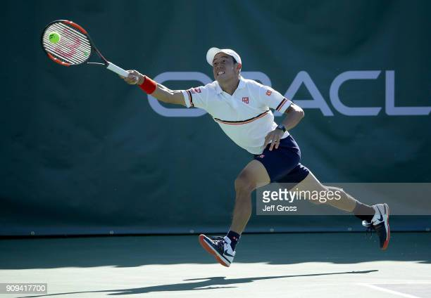 Kei Nishikori of Japan lunges to return a forehand against Dennis Novikov during the first roud of the Oracle Challenger Series at the Newport Beach...